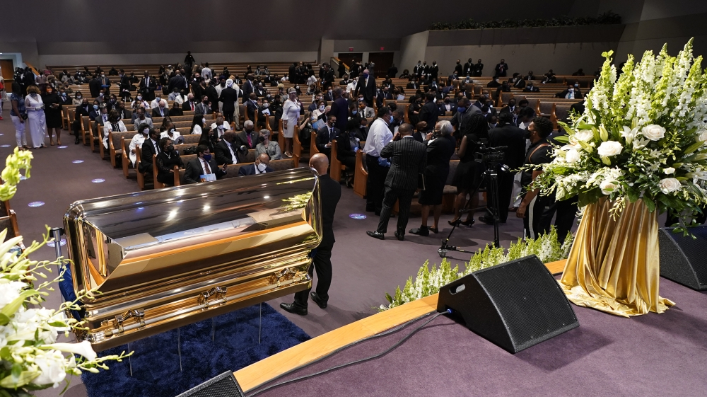 Mourners pause by the casket during a funeral service for George Floyd at the Fountain of Praise church, Houston, Texas, USA, 09 June 2020. A bystander's video posted online on 25 May, appeared to sho