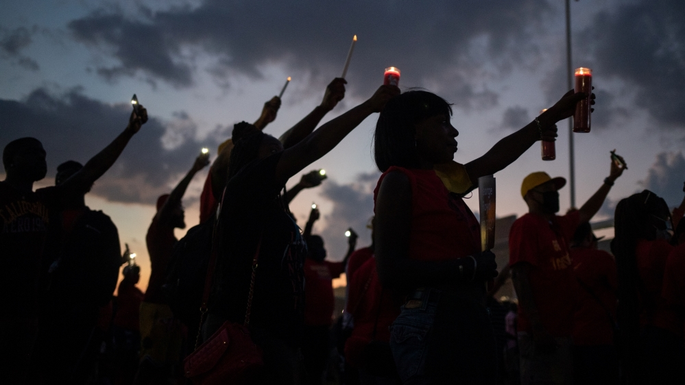Residents take part in candlelight vigil for George Floyd on his high school football field in Houston