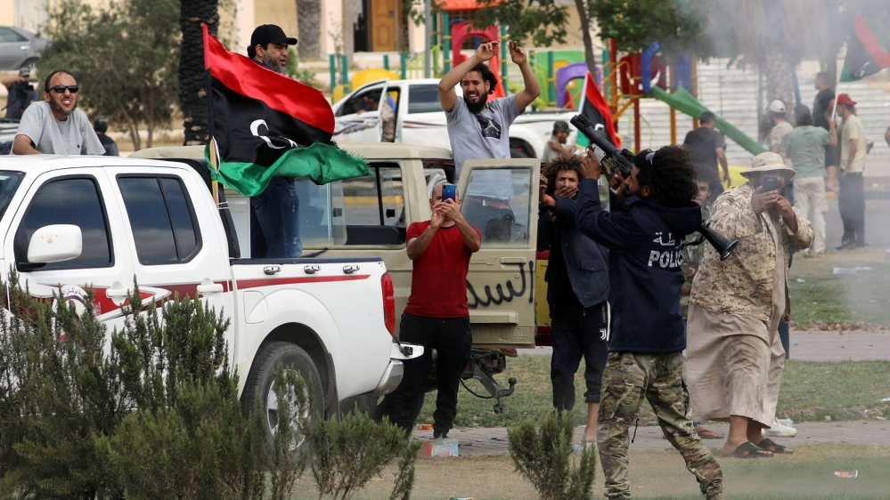 Fighters loyal to Libya's internationally recognised government celebrate after regaining control over Tarhouna city