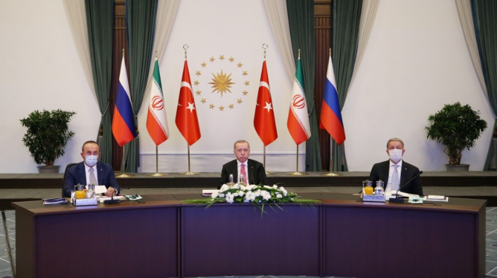 Turkish President Tayyip Erdogan attends a video conference call, dedicated to the conflict in Syria, with Russia's President Vladimir Putin and Iran's President Hassan Rouhani