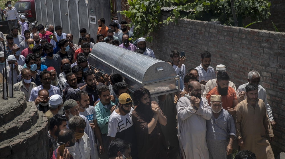 Relatives and neighbors carry the coffin of civilian Bashir Ahmed Khan during his funeral on the outskirts of Srinagar, Indian controlled Kashmir, Wednesday, July 1, 2020. Suspected rebels attacked pa