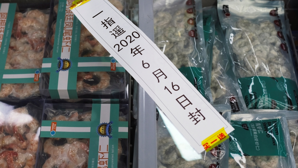 Frozen seafood products made of imported shrimps are seen inside a sealed freezer at a supermarket in Beijing