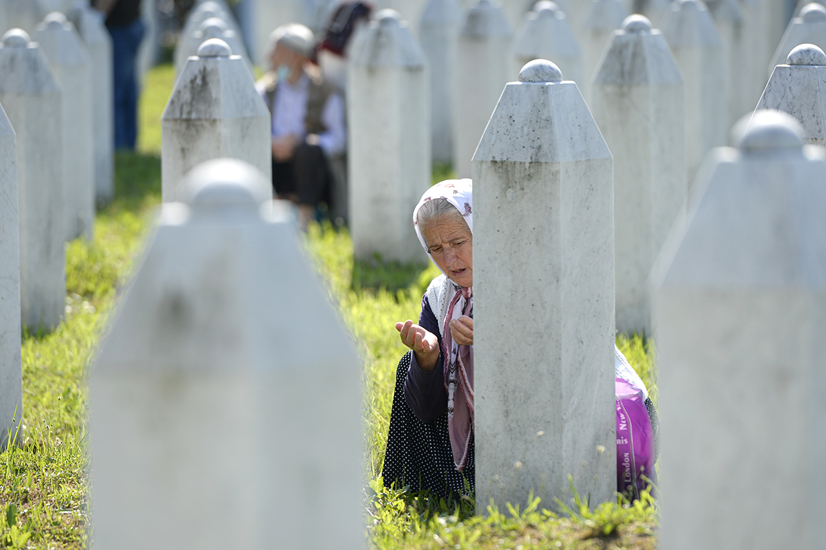 A woman prays in Potocari, near Srebrenica, Bosnia. Nine newly found and identified men and boys were laid to rest as Bosnians commemorate 25 years since more than 8,000 Bosnian Muslims perished in 10 days of slaughter after Srebrenica was overrun by Bosnian Serb forces. The massacre during the closing months of the 1992-95 Bosnian war was Europe's worst since second world war. [Kemal Softic/AP Photo]