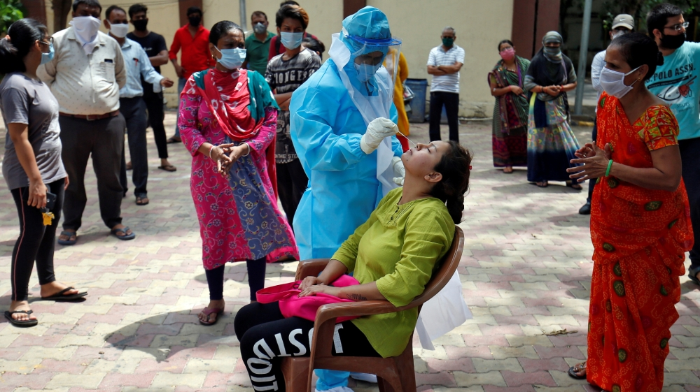 India logs daily record as coronavirus cases exceed 800,000: Live