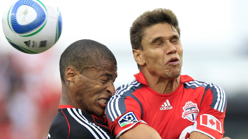 DC United defender Jordan Graye collides with Toronto FC defender Adrian Cann during their MLS soccer game in Toronto
