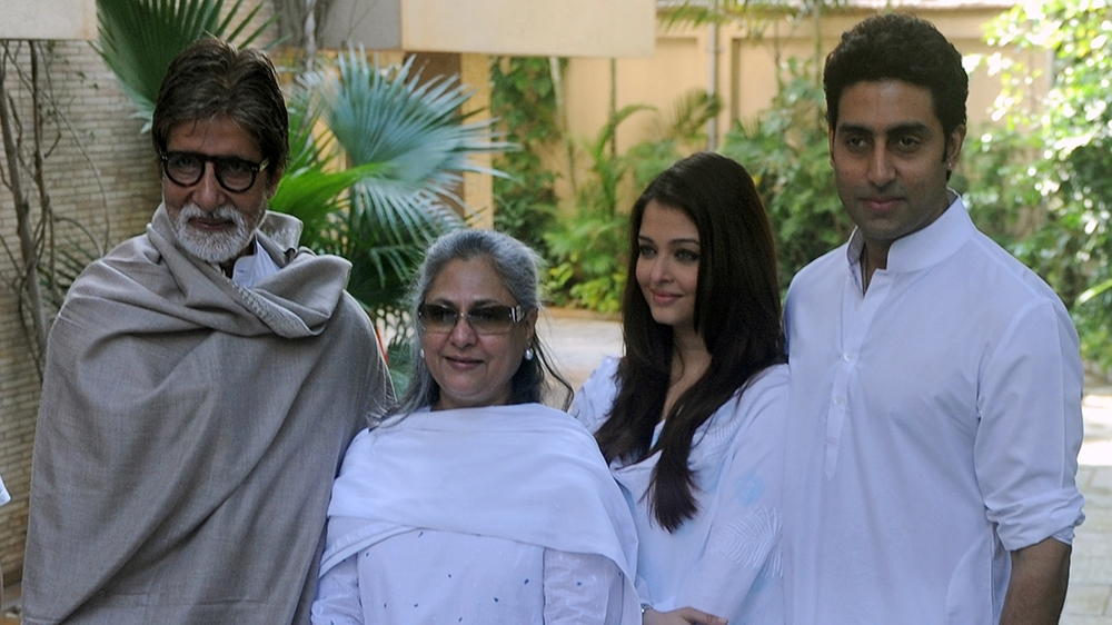Indian Bollywood actor Amitabh Bachchan (L), accompanied by wife Jaya (2nd L) and son Abhishek (R) with wife Aishwarya Rai Bachchan (2nd R) pose following a press conference in Mumbai on February 9, 2