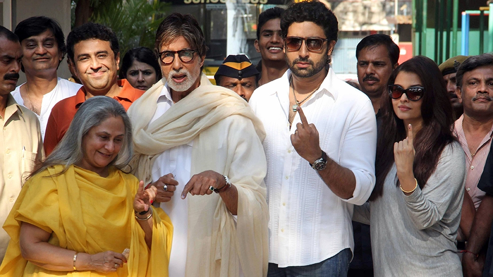 Bollywood actor Amitabh Bachchan second from left, poses with wife Jaya left son Abhishek Bachchan second from right and his wife Aishwarya Rai Bachchan right after casting their votes at a polling st