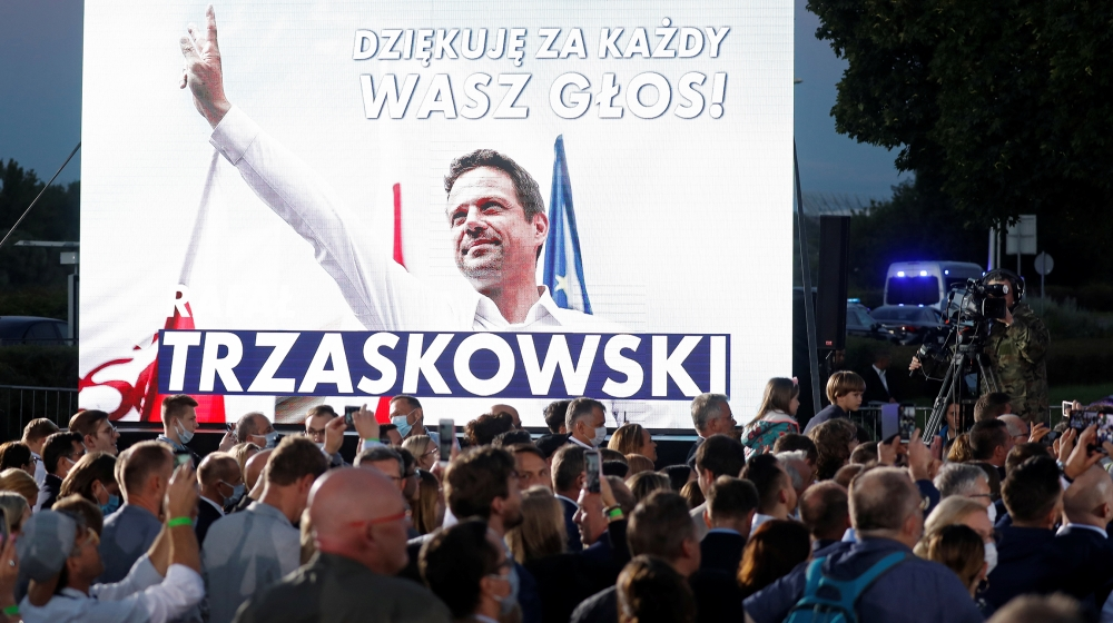 Supporters of Warsaw Mayor Rafal Trzaskowski, presidential candidate of the main opposition Civic Platform (PO) party, react after the announcement of the first exit poll results on the second round o