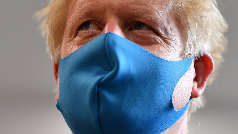 Britain's Prime Minister Boris Johnson, wearing a face mask, visits headquarters of the London Ambulance Service NHS Trust, amid the spread of the coronavirus disease (COVID-19),