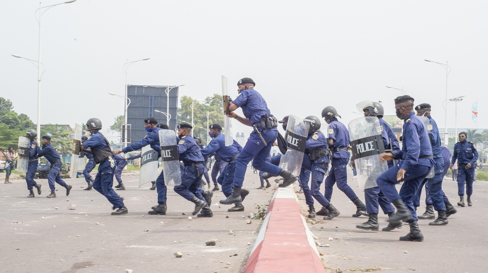 Police officers clash with demonstrators in Kinshasa on July 9, 2020 in demonstrations organized against the presidential party Union for Democracy and Social Progress (UDPS) for the appointment of th