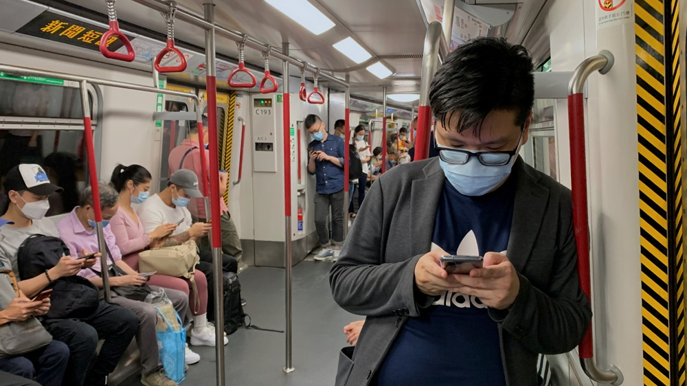Hong Kong adopts toughest-ever coronavirus curbs after case surge