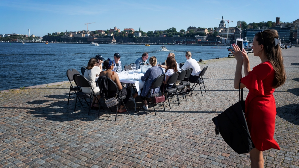 People have a drink after work while keeping a social distance due to the outbreak of the coronavirus disease (COVID-19), in Stockholm