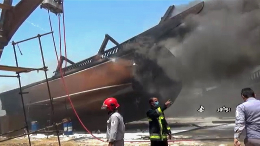 A screen grab taken from a from Iranian State TV IRIB on July 15, 2020, shows firefighters combatting a blaze at the Delvar Kashti Bushehr boat factory in the Iranian city of Bushehr. (Photo by - / IR