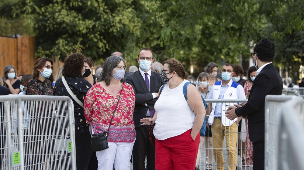 People, wearing protective face mask, queue outside the Grand Palais prior to a reception called by French Health Minister and gathering 800 medical staff that helped during the novel coronavirus (COV