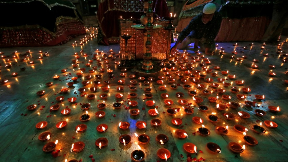 A man lights an oil lamp inside the tomb of Ahmad Shah during a special prayer meeting for the victims of the coronavirus disease (COVID-19), amid the spread of the disease in Ahmedabad,