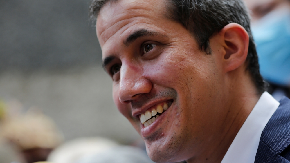 Venezuelan opposition leader Juan Guaido takes part in a news conference after Venezuela's pro-government supreme court replaced the leaders of two key opposition parties