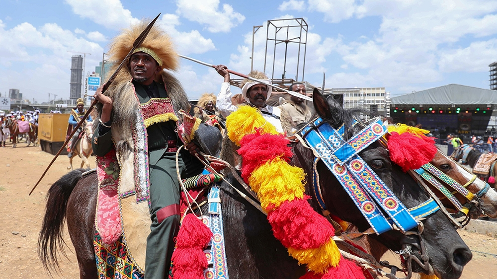 Ethiopian Oromo musician, Haacaaluu Hundeessaa, rides a horse in traditional costume during the 123rd anniversary celebration of the battle of Adwa where the Ethiopian forces defeated the invading Ita