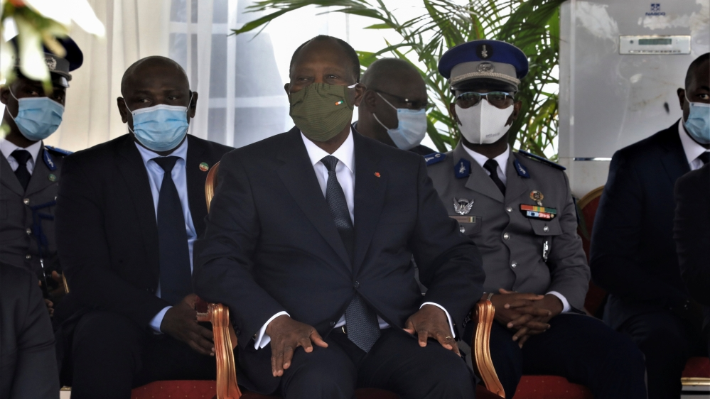 Ivory Coast President Alassane Ouattara attends a national tribute ceremony for dead soldiers, in Abidjan