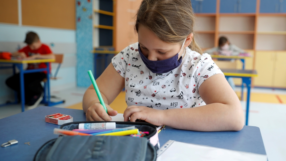 Girl takes lesson after some classes reopened in Warsaw