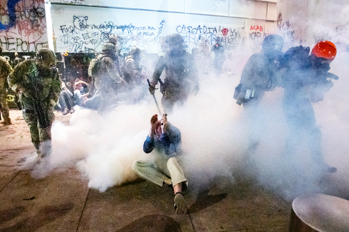 Federal officers use chemical irritants and crowd control munitions to disperse Black Lives Matter protesters outside the Mark O. Hatfield United States Courthouse on Wednesday, July 22, 2020, in Port