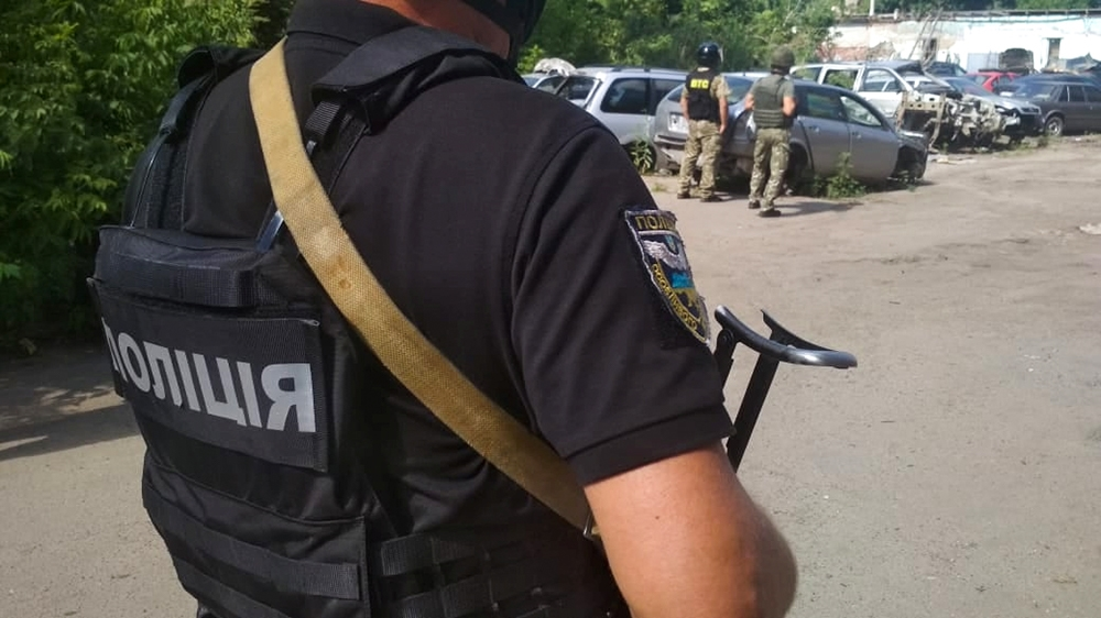 Ukrainian law enforcement officers are seen near a site where a man armed with a grenade holds a policeman hostage in Poltava, Ukraine July 23, 2020. Press Service of the National Police of Ukraine/Ha