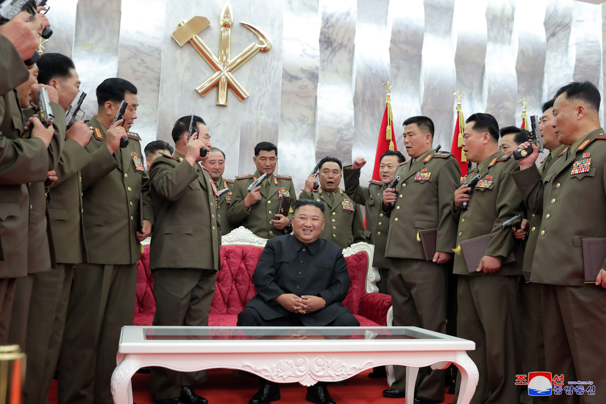 Kim Jong Un conferring 'Paektusan' commemorative pistols on leading commanding officers of the North Korean armed forces on what the occasion of what the state media called 'the 67th anniversary of the Korean people's victory in the great Fatherland Liberation War'. [KCNA via EPA]