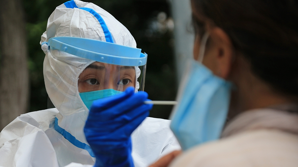 Five Chinese regions hit by new coronavirus outbreak: Live thumbnail