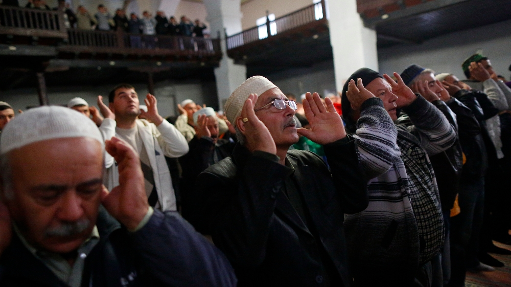 Crimean Tatar muslims pray in the Great Khan Mosque on the first day of the Eid al-Adha (Kurban Bayram) in the city of Bakhchisaray on October 4, 2014.