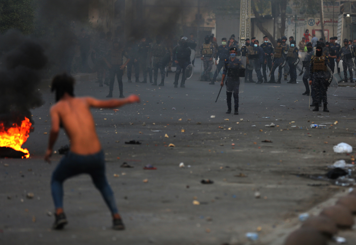 Two protesters were killed during clashes between demonstrators and security forces in central Baghdad late on Sunday. [Ahmad Al-Rubaye/AFP]