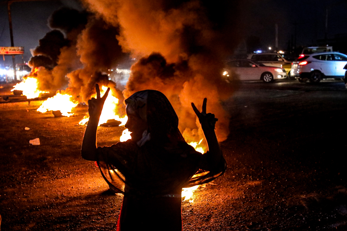 Demonstrators lit fires in the southern city of Basra. [Nabil al-Jurani/AP Photo]