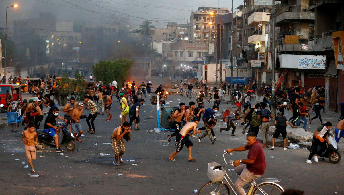 Security forces fired tear gas and live ammunition to disperse crowds. [Thaier al-Sudani/Reuters]
