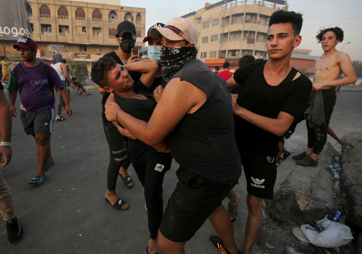It was the first such deadly incident in months at Tahrir Square, the epicentre of massive anti-government protests that first erupted in October last year. [Ahmad Al-Rubaye/AFP]