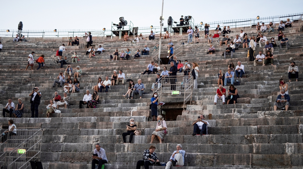 Guests take their seats before a concert at the Arena in Verona, northern Italy, on July 25, 2020. This is the first show with new dispositions against the spread of the novel coronavirus (Covid-19) d