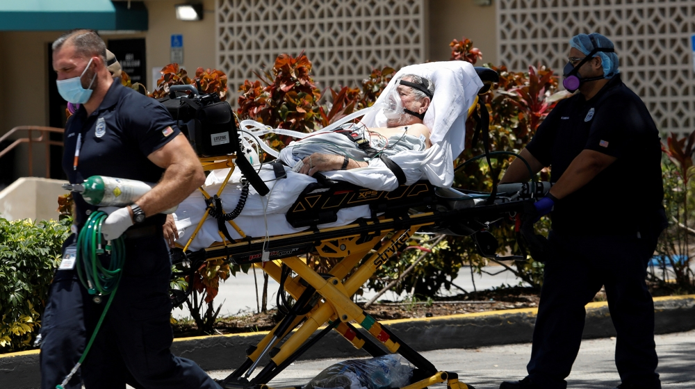 Emergency Medical Technicians (EMT) leave with a patient at Hialeah Hospital where the coronavirus disease (COVID-19) patients are treated, in Hialeah, Florida, U.S., July 29, 2020. REUTERS/Marco Bell