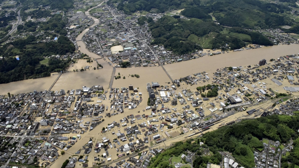 Heavy rain floods southern Japan, leaving more than a dozen missing