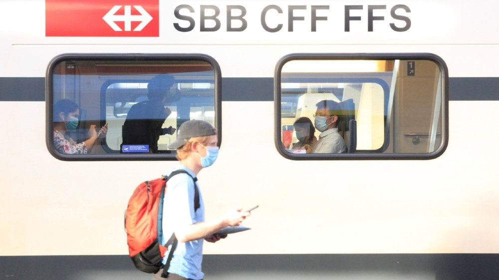 Passengers wear protective masks aboard a train of Swiss railway operator SBB, as the coronavirus disease (COVID-19) outbreak continues, at the Hauptbahnhof central station