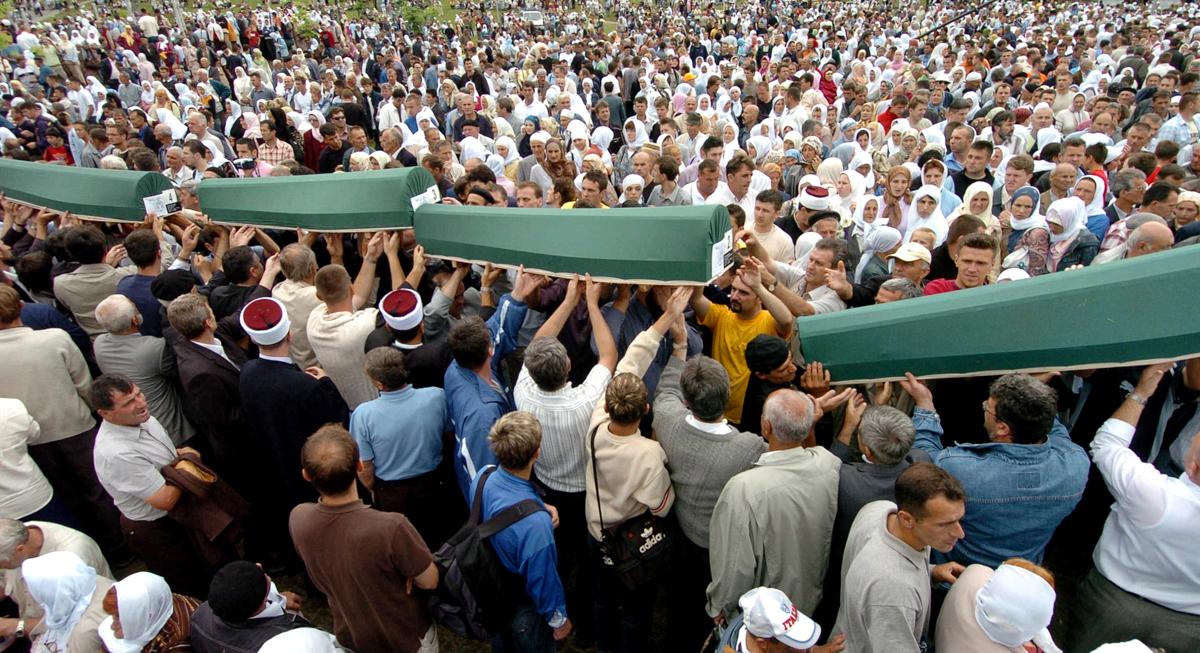 Bosnian Muslim men carry the 610 coffins to be buried at a memorial cemetery in Potocari near the eastern Bosnian town of Srebrenica in this July 11, 2005 photo. [Joe Klamar/AFP]