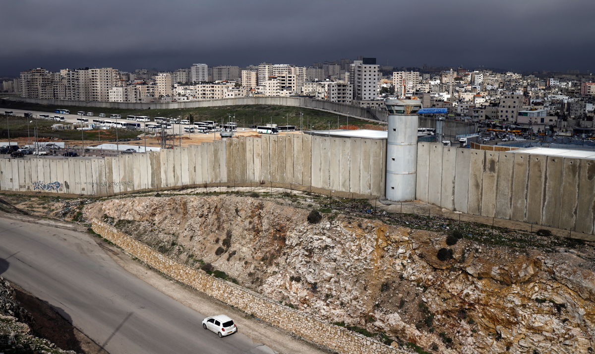 The Israeli separation barrier divides East Jerusalem and the Palestinian West Bank town of Qalandia. [File: Thomas Coex/AFP]
