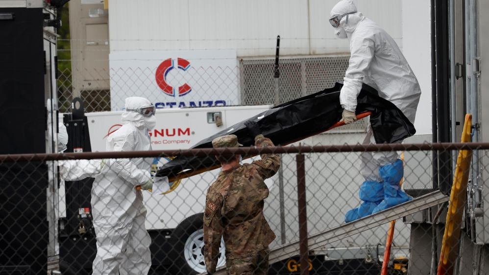 Workers move body of deceased person at University Hospital during outbreak of the coronavirus disease (COVID-19) in Newark