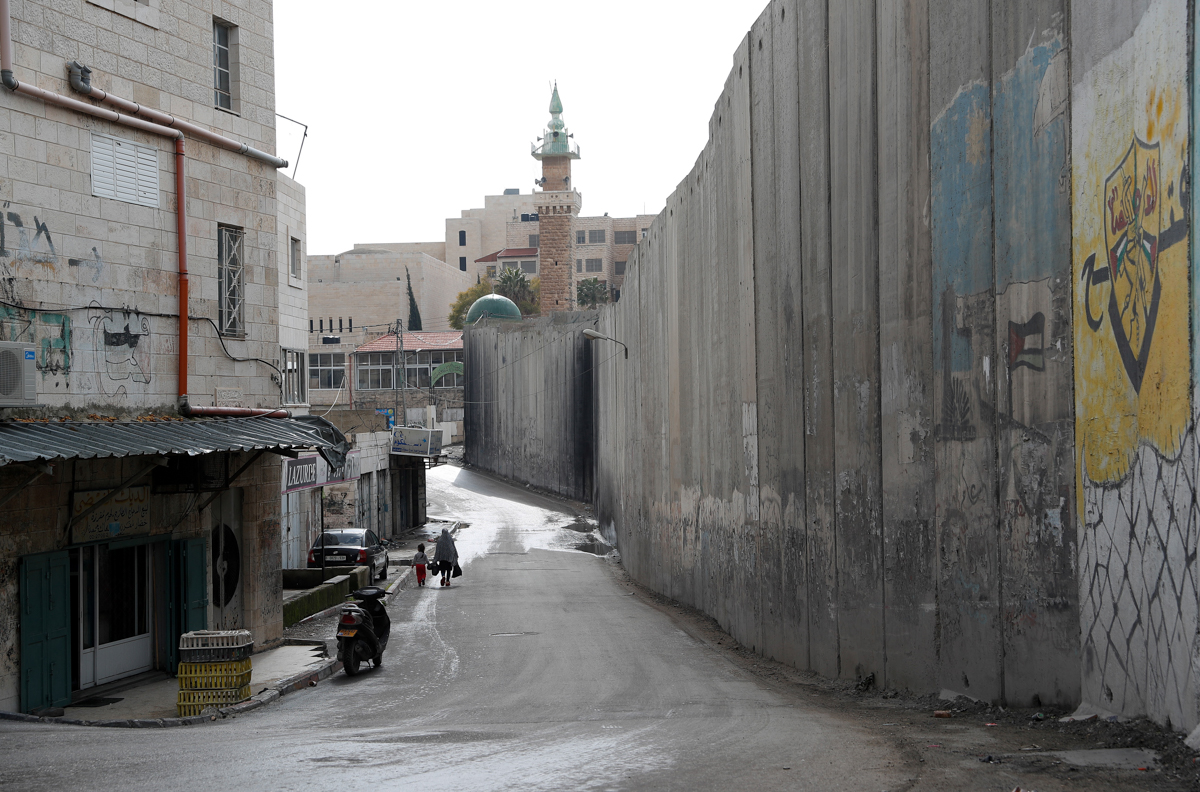 The wall separating East Jerusalem from the Palestinian village of Abu Dis. [File: Emmanuel Dunand/AFP]