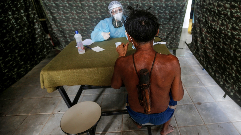 InfoSnipz A member of Brazilian Armed Forces medical team examines a man from the indigenous Yanomami ethnic group, amid the spread of the coronavirus disease (COVID-19), at the 4th Surucucu Special Frontier Pl