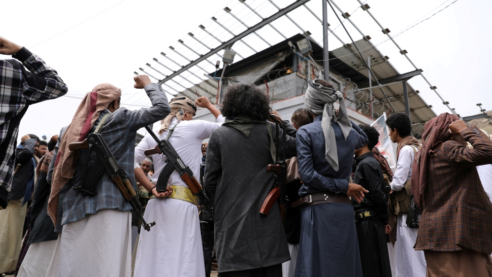 Armed Houthis gather outside the United Nations offices to denounce the Saudi-led coalition's blockade, in Sanaa