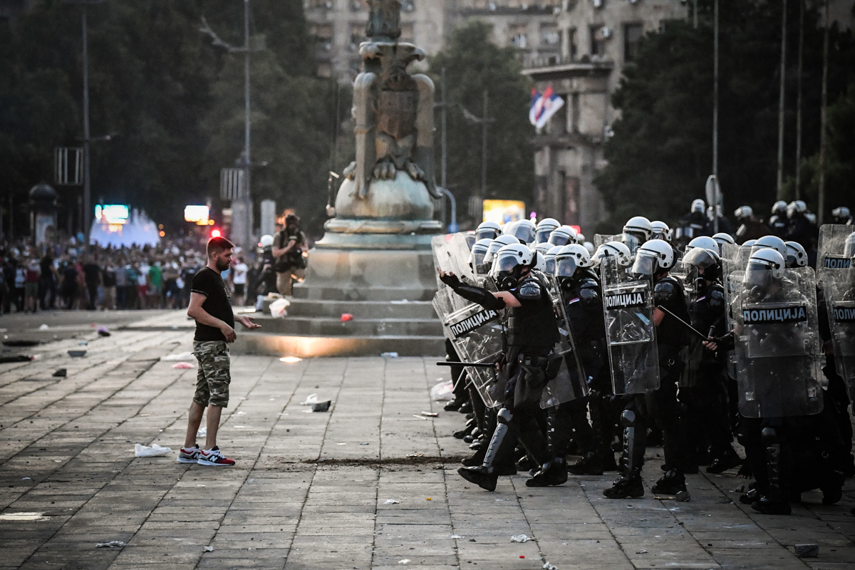 Protesters clash with police in front of Serbia's National Assembly building in Belgrade on July 8, 2020 during a demonstration against a weekend curfew announced to combat a resurgence of COVID-19 in