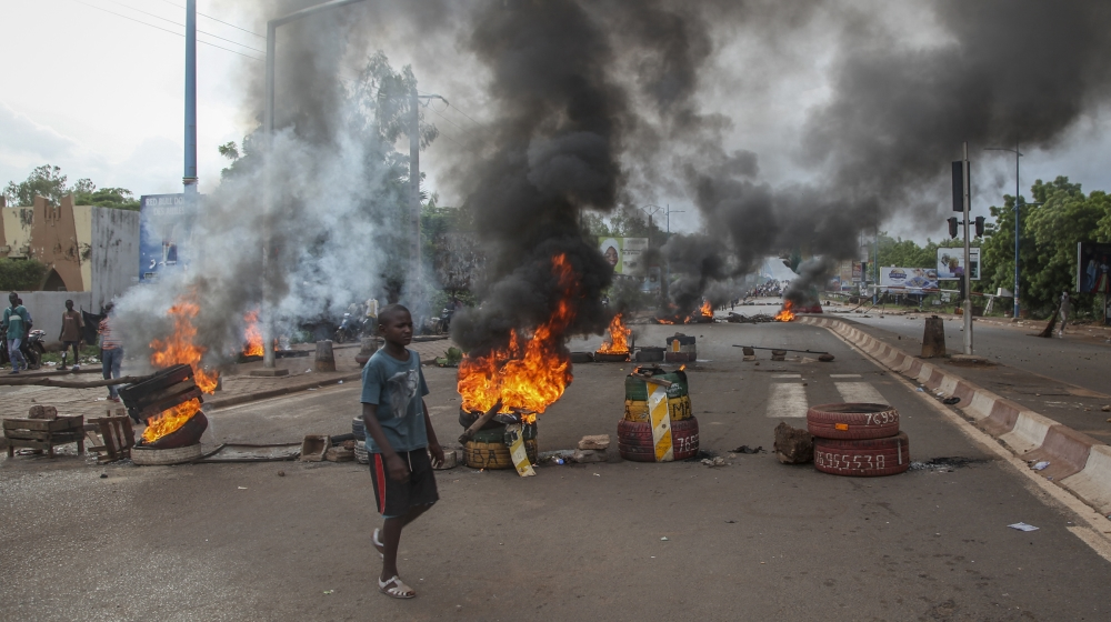 Anti-government protesters burn tires and barricade roads in the capital Bamako, Mali, Friday, July 10, 2020. Thousands marched Friday in Mali's capital in anti-government demonstrations urged by an o