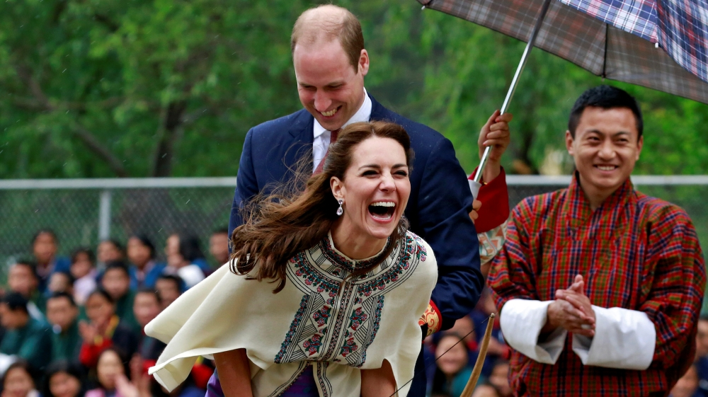 Britain's Catherine, Duchess of Cambridge reacts after shooting an arrow at Changlimithang Archery Ground in Thimphu