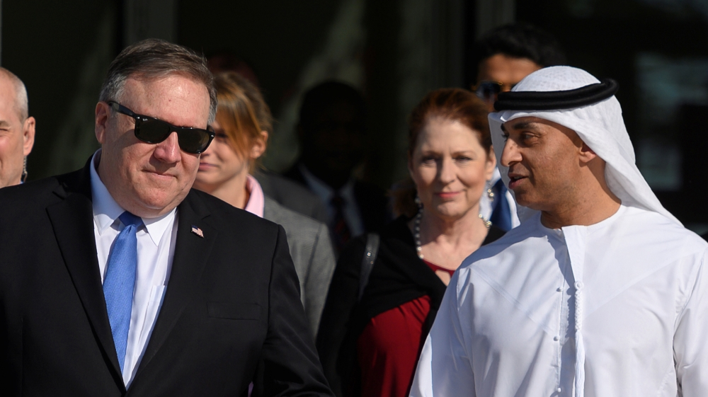 US Secretary of State Mike Pompeo speaks with the Emirati Ambassador to the US Yousef Al Otaiba at the NYU Abu Dhabi campus in Abu Dhabi, United Arab Emirates January 13, 2019.  Andrew Caballero-Reyno