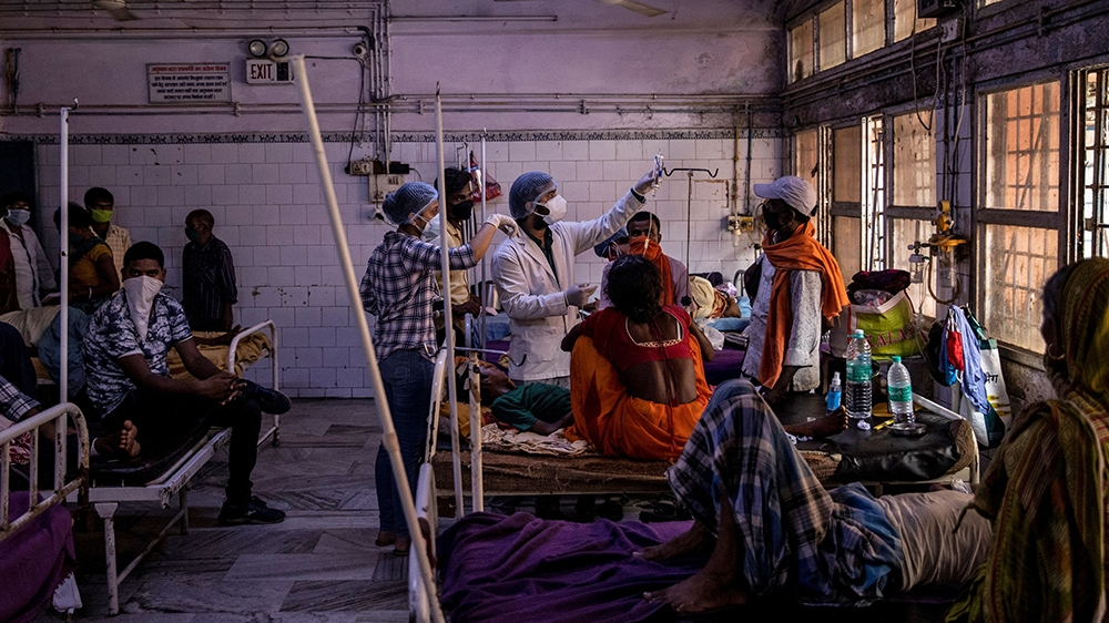 Medical staff treat a patient inside the emergency ward of Jawahar Lal Nehru Medical College and Hospital, during the coronavirus disease (COVID-19) outbreak, in Bhagalpur, Bihar, India, July 27, 2020