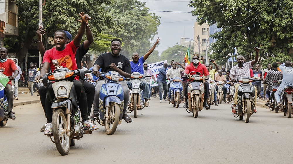 Malians react after Mali military entered the streets of Bamako, Mali, 18 August 2020. Local reports indicate Mali military have seized Mali President Ibrahim Boubakar Keïta in what appears to be a co