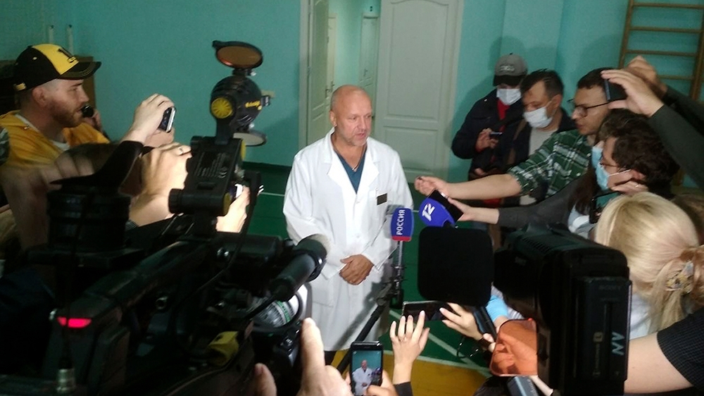 Anatoliy Kalinichenko, deputy chief doctor of the Omsk hospital of intensive care where Alexei Navalny is hospitalized speaks to the media in Omsk, Russia, Thursday, Aug. 20, 2020.  Russian opposition
