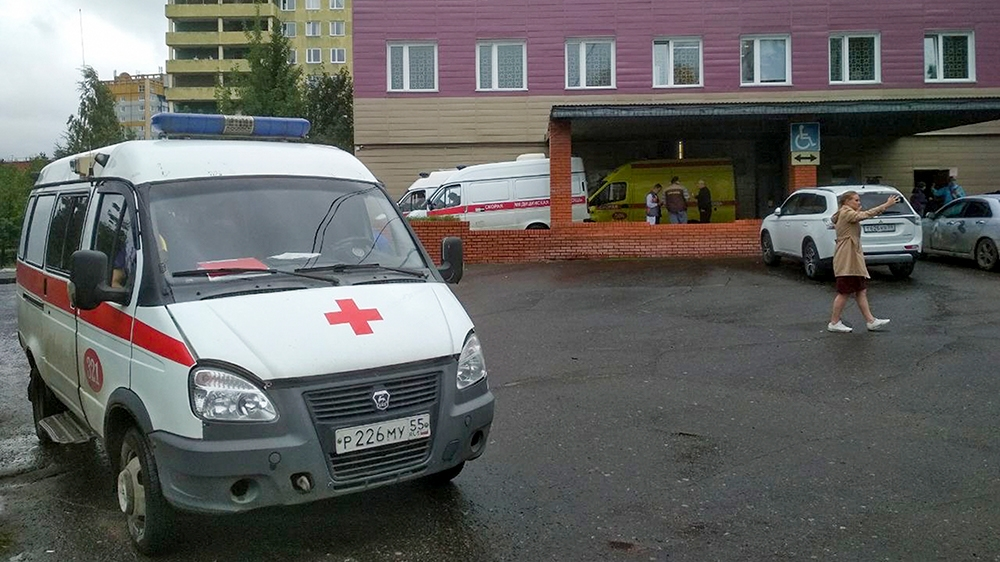 An ambulance parked next to a building of a hospital intensive care unit where Alexei Navalny was hospitalized in Omsk, Russia, Thursday, Aug. 20, 2020. Russian opposition politician Alexei Navalny is